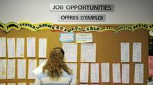 A woman searches a job board at Youth Employment Services in Toronto. (Kevin Van Paassen/The Globe and Mail)