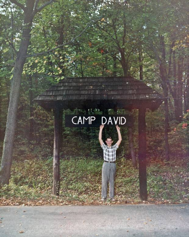 1960: A 12-year-old David Eisenhower, grandson of president Dwight D. Eisenhower, poses with the sign at Camp David, the presidential retreat named in his honour.