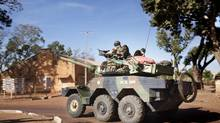 A French armoured all terrain vehicle navigates near the front line in Bamako, Mali, Jan. 19, 2013. Though President Francois Hollande of France has the support of African nations in the region, his army's fight to preserve Mali leaves many saying he has overreached. (MARCO GUALAZZINI/NYT)