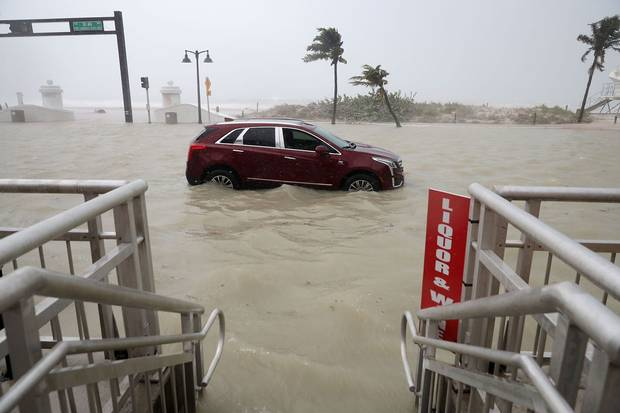 Fort Lauderdale, Fla., Sept. 10: A car sits abandoned in storm surge.