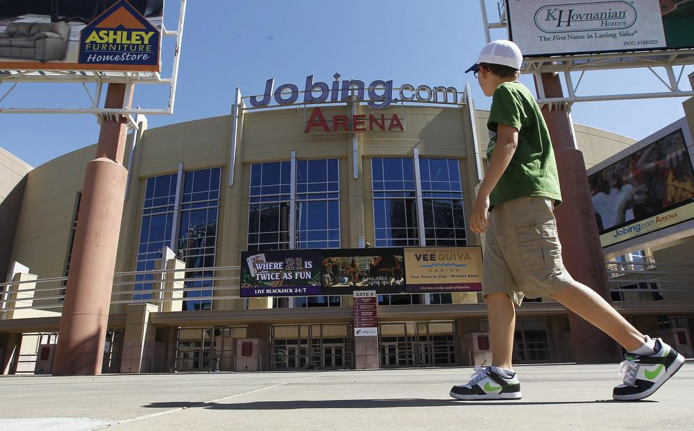 A lone pedestrian walks past Jobing.com Arena, Wednesday, June 13, 2012, in Glendale, Ariz., where the Phoenix Coyotes NHL hockey team plays home games (Ross D. Franklin/AP)