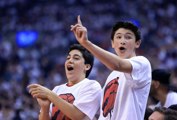 Fans cheers for the Raptors during Game Seven of the Eastern Conference Quarterfinals against the Miami Heat during the 2016 NBA Playoffs at the AirCanada Centre on May 15, 2016 in Toronto, Ontario, Canada.