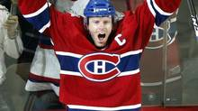 Montreal Canadiens' Saku Koivu celebrates his winning goal against Tampa Bay Lightning during overtime NHL hockey action in Montreal, March, 2009. (Christinne Muschi/REUTERS)