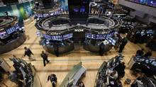 Traders work on the floor of the New York Stock Exchange following its reopening October 31, 2012. U.S. stocks edged higher on Wednesday in the first trading session since a massive storm in the U.S. Northeast forced a two-day market closure (Brendan McDermid/Reuters)