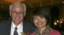 Xinhua News Agency journalist Shi Rong, shown with Conservative MP Bob Dechert, has returned home to China after 'flirtatious' e-mails sent to her by Mr. Dechert surfaced.