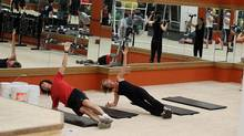 A group of people run through a workout at Extreme Fitness on Bloor Street in Toronto on Nov. 11, 2010. The regime is designed as a simulation of the drills firemen complete. (Fernando Morales/The Globe and Mail/Fernando Morales/The Globe and Mail)