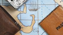 passport and purse on map (Ballun/Getty Images/iStockphoto)