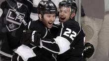 Los Angeles Kings left wing Dustin Penner, left, and teammate Trevor Lewis celebrate a goal by Pe