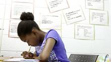 12 year-old Kayvern Lewis, who moved to Canada from St. Vincent, completes a test to determine her math and English skills at We Welcome The World Centre from the Peel District School Board, Aug. 31, 2012. (Fernando Morales/The Globe and Mail)
