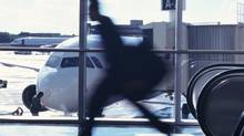A man rushes through an airport. (Stockbyte/Getty Images)
