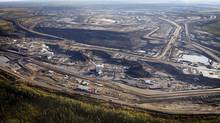 Buyout firm KKR is to open a Calgary office focusing on the oil sands. (Jeff McIntosh/THE CANADIAN PRESS)