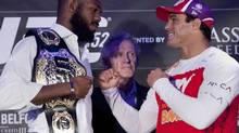 Jon (Bones) Jones, left, and Vitor Belfort, right, pose during the UFC 152 pre-fight press conference at the Real Sports Bar and Grill in Toronto on September 20, 2012. Tom Wright, UFC director of Canadian Operations, is at centre. (Matthew Sherwood/THE CANADIAN PRESS)