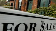"A ""For Sale"" sign is posted outside of at Toronto townhome (Tim Fraser/For The Globe and Mail)"