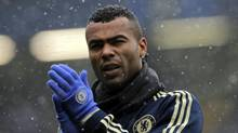 Chelsea's Ashley Cole warms up in the snow before the start of their English Premier League soccer match against Arsenal, at Stamford Bridge, London, Sunday, Jan. 20, 2013. (Sang Tan/AP)