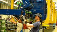 Workers assemble a vehicle at Ludwigsvelde Daimler-Mercedes plant. (Doug Saunders/The Globe and Mail)