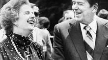 U.S. President Ronald Reagan, right, and Britain's Prime Minister Margaret Thatcher, share a laugh during a break from a session at the Ottawa Summit in this file photo dated July 21, 1981, at Government House in Ottawa, Canada. (Anonymous/AP)