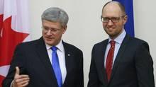 Ukrainian Prime Minister Arseny Yatseniuk, right, meets with Canadian Prime Minister Stephen Harperin Kiev, March 22. (Gleb Garanich/Reuters)