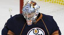 Edmonton Oilers goalie Nikolai Khabibulin makes a save against the Florida Panthers during first-period preseason NHL hockey action in Edmonton, Alberta on Friday, September 18, 2009. (Jimmy Jeong)