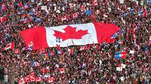 In this Friday, Oct. 27, 1995 file picture, a large Canadian flag is passed through a crowd in as thousands streamed into Montreal from all over Canada to join Quebecers rallying for national unity three days before a referendum that could propel Quebec toward secession. (Ryan Remiorz/THE CANADIAN PRESS)