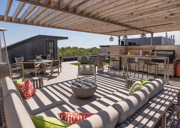 The owners have made extensive use of the rooftop terrace, grilling year-round.
