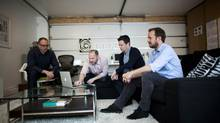 From left, 123w founders Scot Keith, Bryan Collins, Rob Sweetman and Jeff Harrison jam creatively in their new office space. (Rafal Gerszak for The Globe and Mail)
