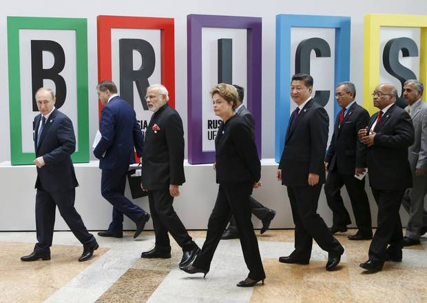 Russian President Vladimir Putin (left), Indian Prime Minister Narendra Modi (third from left), Brazil's President Dilma Rousseff (centre), Chinese President Xi Jinping (fourth from right) and South African President Jacob Zuma (second from right) at the BRICS Summit in Ufa, Russia, on July 9, 2015.