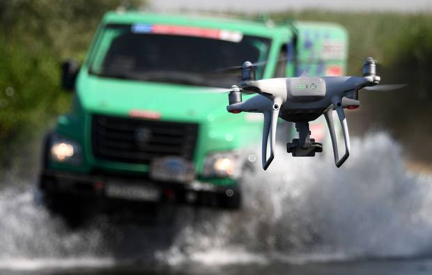 A competitor is filmed by a drone as he competes during the Stage 7 of the Silk Way 2017 between Urdzhar and Karamay, China, on July 14, 2017. Bryce Menzies and his co-driver Peter Mortensen of the U.S. won the stage.