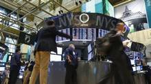 Traders work on the floor at the New York Stock Exchange, May 31, 2013. (BRENDAN MCDERMID/REUTERS)