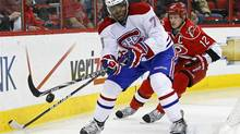 Montreal Canadiens' P.K. Subban controls the puck as Carolina Hurricanes' Eric Staal (12) chases during the first period of an NHL game in Raleigh, N.C., Thursday, April 5, 2012. (Gerry Broome/AP)