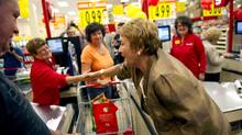 PQ Leader Pauline Marois, who leads most polls ons at a grocery store in Lachute, Que., on Friday, August 31, 2012. (Paul Chiasson/THE CANADIAN PRESS)