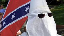 A Ku Klux Klan member attends a demonstration in Huntsville, Texas, on June 22, 2000. (ADREES LATIF/REUTERS)