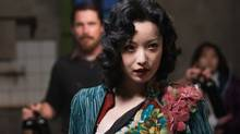 "Christian Bale as John Miller (background) and Ni Ni as Yu Mo in ""The Flowers of War"" (Wrekin Hill Entertainment)"