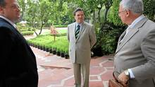 Canadian Finance Minister Jim Flaherty surrounded by aides after at a press conference at the Taj Mahal hotel in New Delhi, India on a visit to meet economic leaders.