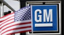 The U.S. flag flies at the Burt GM auto dealer in Denver (RICK WILKING/REUTERS)