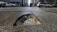 Potholes can cause severe damage to your car. (Fred Lum/The Globe and Mail)
