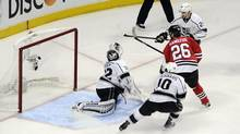 Chicago Blackhawks center Michal Handzus (26) scores the game-winning goal past Los Angeles Kings goalie Jonathan Quick (32) during the second overtime in Game 5 of the Western Conference Final of the 2014 Stanley Cup Playoffs at United Center, May 28, 2014. (David Banks/USA Today Sports)