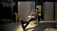 """Actor Sergio Di Zio reads on the set of """"Flashpoint"""" in Toronto. (Kevin Van Paassen / The Globe and Mail)"""