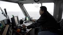Captain Dean Robinson guides his boat through Hecate Strait near Prince Rupert, B.C., on Dec. 11, 2012. Hecate Strait is where tankers serving the Northern Gateway pipeline would be navigating. (Jonathan Hayward/The Canadian Press)
