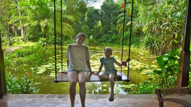 Hanging out at Apa Villa Illuketia, an old colonial plantation that's now a hotel with extensive gardens. After this photo was taken we saw a monitor lizard in the pond. (Ellen Himelfarb)