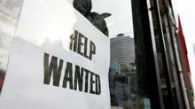 File photo of a help wanted sign in the window of a store in downtown Toronto. (Charla Jones)