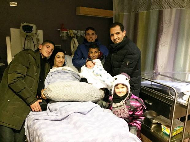 The Alkarnake family poses with baby Eyad, who was born almost immediately after they arrived in Fort McMurray.