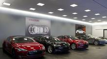 Tesla Model S's, foreground, and Roasters, background, sit on display at the Tesla dealership in Toronto. (Matthew Sherwood For The Globe and Mail)