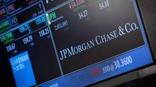 A screen displays JP Morgan Chase & Co. on the floor of the New York Stock Exchange in this file photo taken October 21, 2013. (Brendan McDermid/Reuters)
