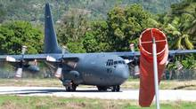 A Canadian Forces Hercules transport plane attempts a take-off on the 1,000-metre runway at the airport in Jacmel, Haiti on Jan. 18, 2010. (Adrian Wyld/The Canadian Press)