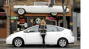 Gemini-award winning actress Helene Joy and her Toyota Prius outside the Cadillac Lounge in Toronto.