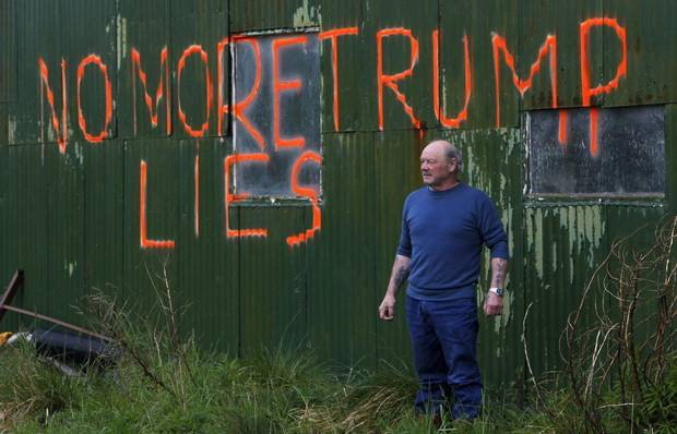 Scottish fisherman Michael Forbes poses for a photograph by the side of a building on his property near Aberdeen in 2010.