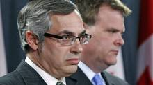 Treasury Board President Tony Clement and Minister of Foreign Affairs John Baird respond to the Auditor-General's report into G8 spending at an Ottawa news conference on June 9, 2011. (BLAIR GABLE/REUTERS)