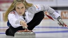 Skip Jennifer Jones throws her rock against Team Middaugh during the women's final at the Roar of the Rings Canadian Olympic Curling Trials in Winnipeg, December 7, 2013. (FRED GREENSLADE/REUTERS)