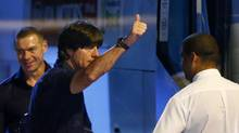 Germany's national soccer team coach Joachim Loew gives a thumbs-up (ARND WIEGMANN/REUTERS)