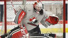 Team Canada goalie Shannon Szabados practices in Calgary on Jan. 15, 2014, in preparation for the Sochi Olympics (Jeff McIntosh/THE CANADIAN PRESS)